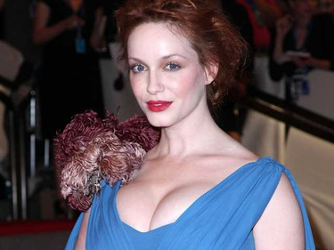 'Mad Men' beauty Christina Hendricks is hiding a saucy secret - the flamed-haired bombshell posed for a series of sexy snaps in a 1999 edition of Playboy magazine. (Andres Otero/WENN.com)