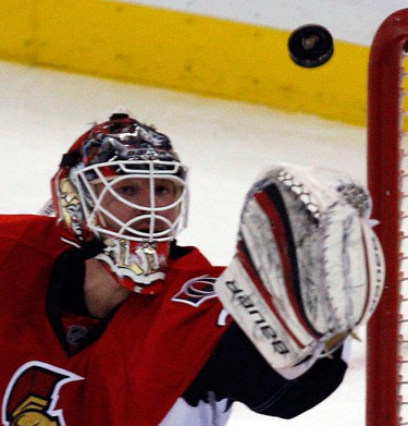 Ottawa Senators' goalie Brian Elliott (30) eyes a flying puck while playing the Calgary Flames during the second period of NHL action at Scotiabank Place in Ottawa Friday, January 14, 2011. (Darren Brown/Ottawa Sun)