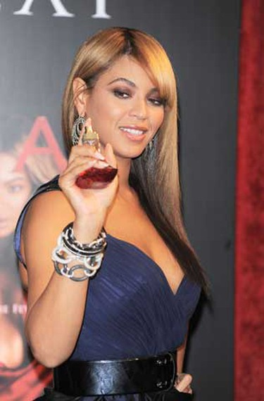 Beyonce poses with her fragrance Heat. (Michael Carpenter/WENN)