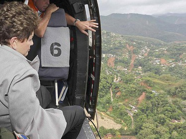 Brazil's President Dilma Rousseff looks at the area affected by flooding and landslides in Nova Friburgo January 13, 2011. (Reuters)