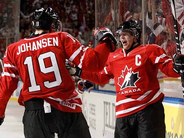 Canada's Ryan Ellis celebrates his power play goal with teammate Ryan Johansen after scoring on Russia. (REUTERS/Mark Blinch)