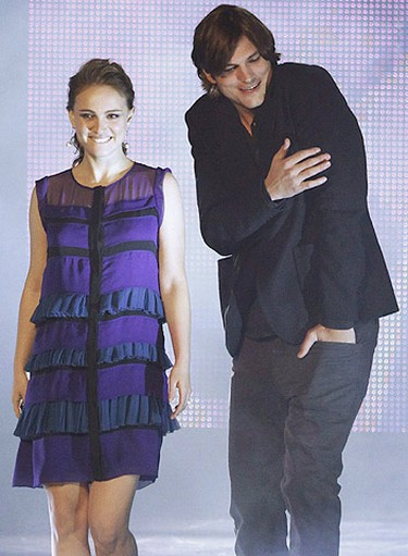 Presenters Natalie Portman and Ashton Kutcher are seen on stage at the 2011 People's Choice Awards in Los Angeles January 5, 2011. (Reuters)