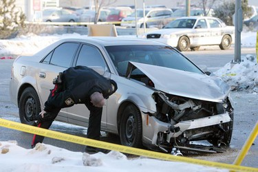Police investigate a crash at Sargent Avenue and King Edward Street Jan. 3, 2011. The male driver of the taxi was taken to hospital in critical condition, while a male taxi passenger and the second vehicle's driver were also injured, but in stable condition after the crash. (MARCEL CRETAIN/Winnipeg Sun)