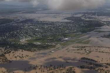 An aerial view of Rockhampton surrounded by floodwaters in the state of Queensland Jan. 2, 2011. REUTERS/Daniel Munoz