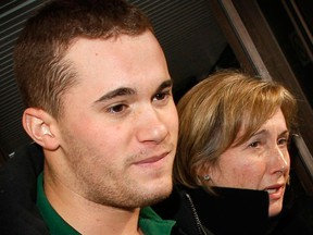 """The son of former Newfoundland premier Brian Tobin, John """"Jack"""" Tobin,  leaves Ottawa court with his mother Jodean after being charged back on December 25, 2010. (Ottawa Sun file photo)"""