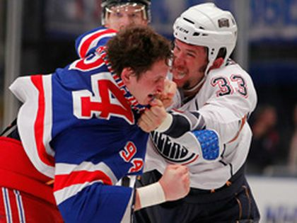 Oilers' enforcer Steve MacIntyre fights with Rangers heavyweight Derek Boogaard during the third period at Madison Square Garden on Sunday.