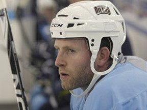 Ryan Whitney watches the action from the bench during the Oilers training camp. (PERRY NELSON/QMI Agency)