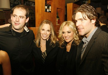 Chris Phillips, wife Erin, Carrie Underwood and Mike Fisher were at Fratelli's restaurant in Kanata for a silent auction and dinner fundraiser Tuesday night. Nov. 24, 2010. DOUG HEMPSTEAD/Ottawa Sun