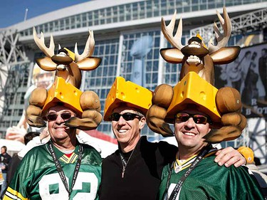 Three Green Bay Packers cheeseheads stand outside of Cowboys Stadium. (REUTERS/Mike Segar)
