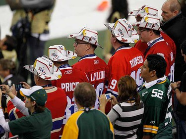 Football fans wear the NHL Montreal Canadiens uniforms prior to the NFL's Super Bowl XLV. (REUTERS/Gary Hershorn)