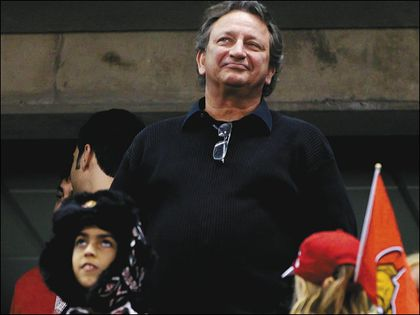 Senators owner Eugene Melnyk salutes the fans after Thursday's final home game of the season. (ERROL McGIHON/Ottawa Sun)
