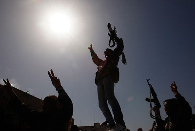Mourners hold up their rifles during the funeral of rebels, killed during clashes in Brega with forces loyal to Libyan leader Moammar Gadhafi, in Benghazi March 3, 2011. REUTERS/Suhaib Salem