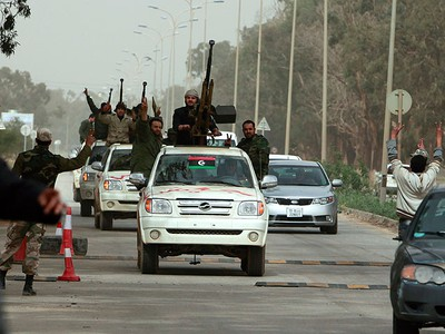 Anti-government rebels greet one another at a check point in Benghazi March 2, 2011 while on their way to Ajdabia area, 150 km south west of Benghazi, to prepare for a possible pro-government attack there. (REUTERS/Asmaa Waguih)