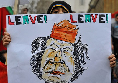 Anti-Gaddafi protestors demonstrate in Whitehall in central London February 22, 2011. REUTERS/Toby Melville
