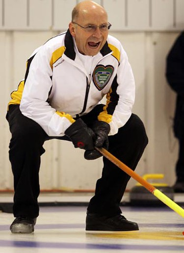 Manitoba skip John Usackis calls in a rock during the Canadian Masters Curling final in Winnipeg Tuesday, April 5, 2011. The Team 'Toba women went on to win the crown. (BRIAN DONOGH/Winnipeg Sun)