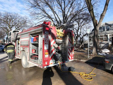 Emergency crews attend a scene of a fire at 717 Jessie Ave. early Monday, April 4, 2011. Some animals perished in the blaze. (MARCEL CRETAIN/Winnipeg Sun)