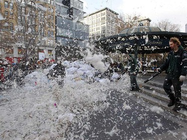 A city worker uses a leaf blower to remove feathers left behind from New York City's sixth annual Pillow Fight Day in New York's Union Square April 2, 2011. REUTERS/Jessica Rinaldi