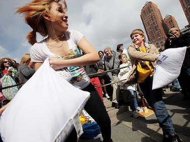 Fighters battle in Manhattan's Union Square during a massive pillow fight on April 2, 2011 in New York City. Over 130 cities worldwide are participating in the fourth annual International Pillow Fight Day.   Mario Tama/Getty Images/AFP