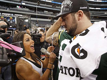 Green Bay Packers guard Evan Dietrich-Smith (rightR) has his bicep measured by reporter Rebeca Rubio during media day for Super Bowl XLV at Cowboys Stadium in Arlington, Texas, on Tuesday, Feb. 1, 2011. (REUTERS/Jeff Haynes)