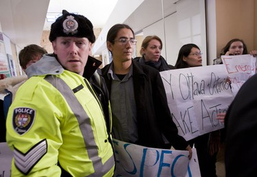 Sgt. Denis Hull of the Ottawa Police Service informed six protestors outside of Mayor Jim Watsons office that they have the the choice of leaving the building or face being ticketed under the trespass act. The protestors against the development of the South March Highlands chose to leave peacefully. Tuesday February 1,2011. (ERROL MCGIHON/THE OTTAWA SUN)