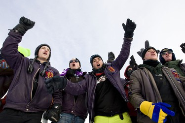 Queens University students  Luka Ledoux, left to right, Adam Silvester, and Daniel Marinescu,  cheer with others during the Great Northern Concrete Toboggan Race at Gallagher Park  in Edmonton, Alta., on Saturday, January 29 2011.  The University of Alberta hosted the 37th annual year of the national competition that brings civil engineering students together to test their concrete designs.   (AMBER BRACKEN/EDMONTON SUN/)