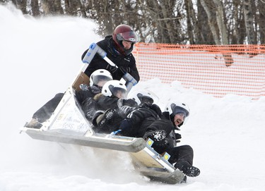 Students wipe out on their sled during the Great Northern Concrete Toboggan Race at Gallagher Park  in Edmonton, Alta., on Saturday, January 29 2011.  The University of Alberta hosted the 37th annual year of the national competition that brings civil engineering students together to test their concrete designs.   (AMBER BRACKEN/EDMONTON SUN/)