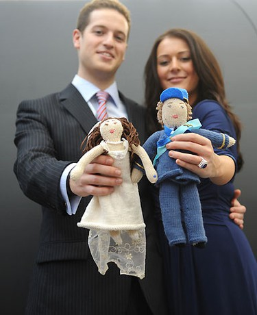 Kate Bevan, a Kate Middleton look-a-like, and a ringer for Prince William pose with knit William and Kate dolls in London. (WENN.COM)
