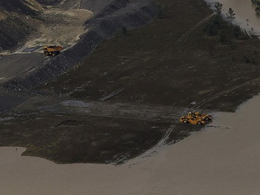 Machinery is seen at a coal mine, surrounded by floodwaters, in Baralaba, Queensland Jan. 2, 2011. Large parts of Australia's coastal northeast were flooded on Sunday in a spreading environmental disaster as thousands of residents fled their homes to avoid the runoff from a Christmas deluge. REUTERS/Daniel Munoz