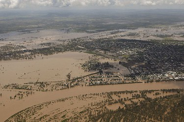 An aerial view of partially submerged houses in flooded Rockhampton in Australia's state of Queensland Jan. 2, 2011.  REUTERS/Daniel Munoz