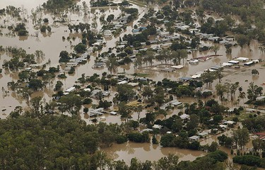 An aerial view of partially submerged houses in flooded Theodore in Australia's state of Queensland Jan. 2, 2011.  REUTERS/Daniel Munoz