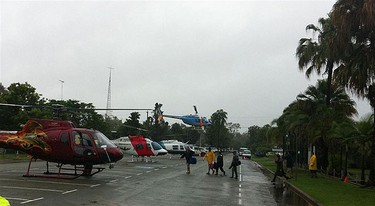 A main street in the flooded town of Theodore, about 410km (255 miles) north west of Brisbane, is used as a helicopter landing zone as residents are evacuated in this Jan. 1, 2011 handout picture.   REUTERS/Queensland Police Service/Handout