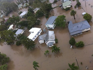 Houses in the town of Theodore, about 410 km north west of Brisbane, are partially submerged by flood waters in this Jan. 1, 2011 handout picture. REUTERS/Queensland Police Service/Handout
