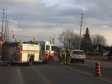 Fire crews, police and Ottawa paramedics were on standby for several hours Thursday morning at the scene of a gas line rupture along Hazeldean Rd. in Stittsville in west Ottawa. Gas crews eventually capped the leak and the road was to reopen before noon. The paramedic service bus was called in to keep evacuees from nearby buildings out of the cold. (DOMINIC FIORENZA Ottawa Sun)