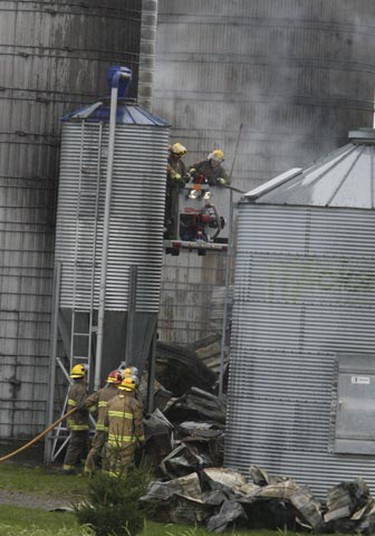 Ottawa fire crews spent Friday morning battling a major barn fire near Sarsfield. It caused $1M in damage, and killed about 70 head of cattle on the dairy/beef operation run by the family of Henri Joly. Crews spent most of the morning dousing hot spots and inspecting adjacent buildings to ensure all the flames were out. (DOUG HEMPSTEAD Ottawa Sun)