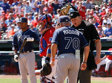 Tampa Bay Rays manager Joe Maddon (2nd L) speaks with home plate umpire Bill Miller, as Rays' hitter Carl Crawford stands at left with Texas Rangers catcher Bengie Molina (2nd L) in the third inning during Game 4 of their American League Division Series MLB baseball game in Arlington, Texas on Oct. 10, 2010. (REUTERS)