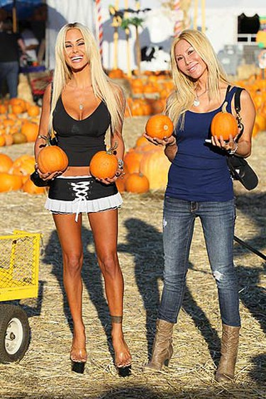 Playboy Playmate Shauna Sands picks a pair while visiting a pumpkin patch in West Hollywood with her family and friends on Oct. 8, 2010. (WENN.com)