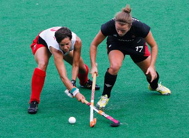 Canada's Robyn Pendleton (R) and Wales' Claire Lowry fight for the ball during their women's hockey group match at the Commonwealth Games in New Delhi on Oct. 8, 2010. (REUTERS)