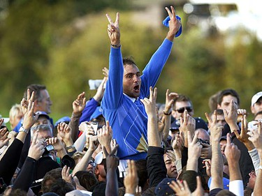 Edoardo Molinari celebrates with fans after Europe won the Ryder Cup at Celtic Manor in Newport, Wales on Monday, Oct 4, 2010. (REUTERS/Eddie Keogh)