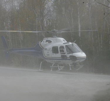 The OPP search helicopter lands on Damtop Road, about 10 km away from where the bodies were found. Oct. 3, 2010. DOUG HEMPSTEAD/Ottawa Sun