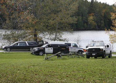 The body of a man is loaded into a hearse at the boat launch on Centennial Lake around 4 p.m. Sunday. Oct. 3, 2010. DOUG HEMPSTEAD/Ottawa Sun