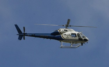 An OPP search helicopter circles the mobile command post preparing to land. Oct. 3, 2010. DOUG HEMPSTEAD/Ottawa Sun