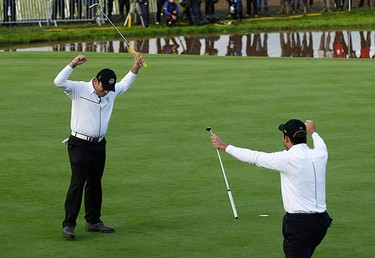 European Ryder Cup players Francesco (L) and Edoardo Molinari of Italy celebrate on the 18th green after halving their fourball match on the third day of the 2010 Ryder Cup at Celtic Manor in Newport, south Wales on Oct. 3, 2010. (REUTERS)