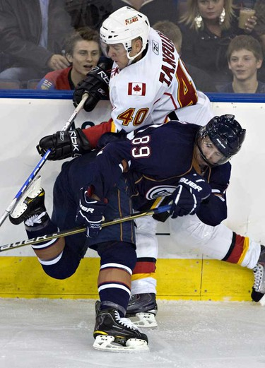 The Calgary Flames Alex Tanguay gets tangled with Edmonton Oilers Sam Gagner during NHL action at Rexall place. ( JORDAN VERLAGE/EDMONTON SUN)