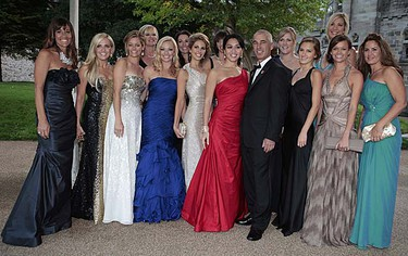 The wives and girlfriends of the U.S. Ryder Cup golf team pose with captain Corey Pavin (centre) before the welcome dinner at Cardiff Castle in Cardiff, Wales on Wednesday, Sept. 29, 2010. (REUTERS/Heathcliff O'Malley)