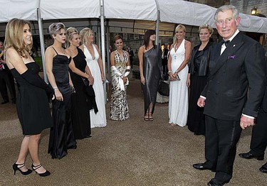 Britain's Prince Charles (right) meets the wives and girlfriends of the European Ryder Cup golf team before the welcome dinner at Cardiff Castle in Cardiff, Wales on Wednesday, Sept. 29, 2010. (REUTERS/Heathcliff O'Malley)