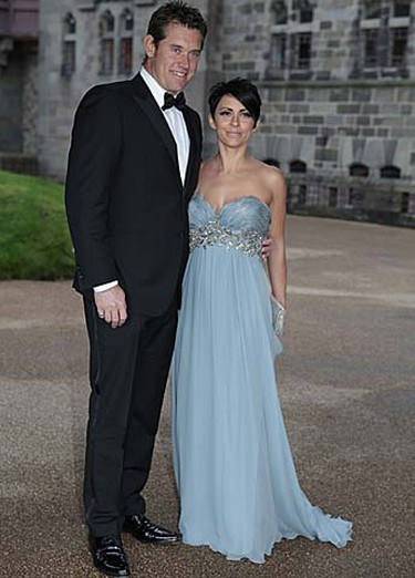 Europe Ryder Cup golf team member Lee Westwood of England poses with his wife Laurae before the welcome dinner at Cardiff Castle in Cardiff, Wales on Wednesday, Sept. 29, 2010. (REUTERS/Heathcliff O'Malley)