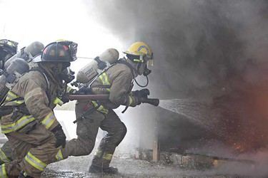 Firefighters put out a burning shed. (CODIE MCLACHLAN/EDMONTON SUN)