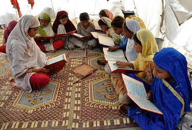Girls read the Quran in a camp for flood victims in Pakistan's Muzaffargarh district of Punjab province August 20, 2010. Pakistan said it will clamp down on charities linked to Islamist militants trying to exploit anger among flood victims, amid fears their involvement in the relief effort would undermine the fight against groups like the Taliban.  (REUTERS)