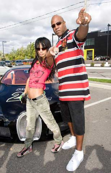 """Actors Bai Ling and Tiny Lister get into the spirit at the third annual Rally for Kids with Cancer Scavenger Cup in Toronto on Sept. 25, 2010. Participating teams raised money for the event and were paired with celebrity """"navigators"""" who led them to various pit stops throughout Toronto in exotic cars. (ALEX UROSEVIC, Toronto Sun)"""