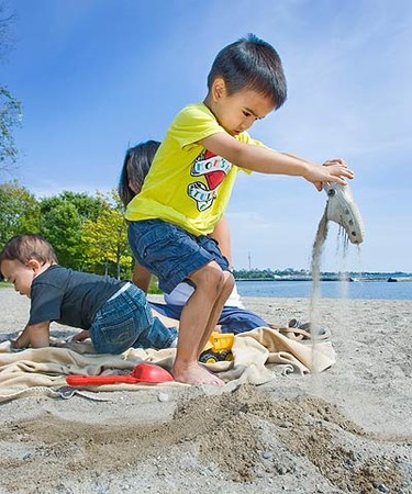 Jace Goring, 3, clears the sand out of his shoes after mom had playfully buried it in the sand in the western beaches in Toronto near the Humber River on Sept. 21, 2010. (ERNEST DOROSZUK, Toronto Sun)
